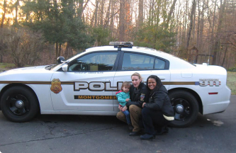two policewoman and a kid